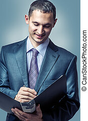 handsome young businessman writing