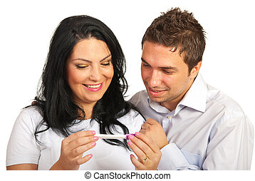 Happy couple looking at pregnancy test - Happy couple...