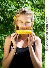 mulher, comer, espiga milho