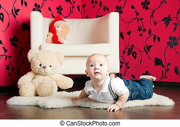 Lying Little Boy - little boy in jeans lying on a carpet...