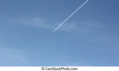 jet stream of airplane going in blue sky