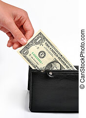 hand-pulling the dollar from purse isolated