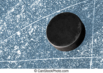 hockey puck on ice ring