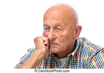 Portrait of a thoughtful senior man looking away