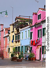 Colorful buildings in Burano island sunny street