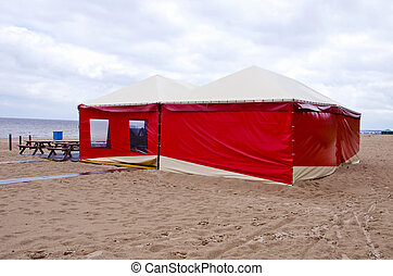 red summer resort cafe tent on sea beach in morning
