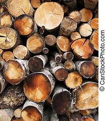 Firewood Background - Frontal view of firewood stacked in a...