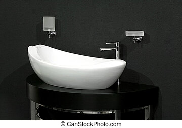 Basin over black - Oval shape white basin over black wall