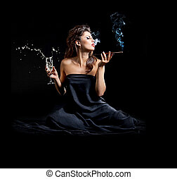 Glamour women with champagne and cigarette on black...
