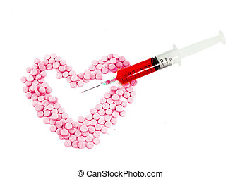 Syringe and pink pills form heart shape isolated on white...
