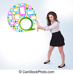Young business woman presenting colourful speach bubble on...