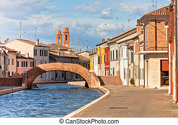 Comacchio, Italy - Canal and colorful houses - Comacchio...