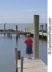 Boy on a Pier