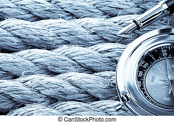 compass with pen on ship ropes - compass with ink pen on...