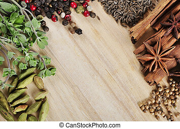 spices and herbs - Aromatic spices and herbs on wooden...