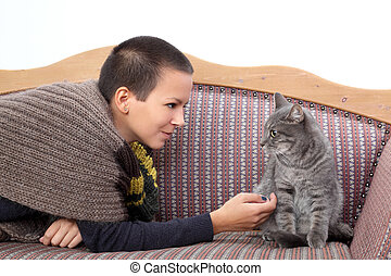Girl and cat - Young woman and gray domestic cat at sofa