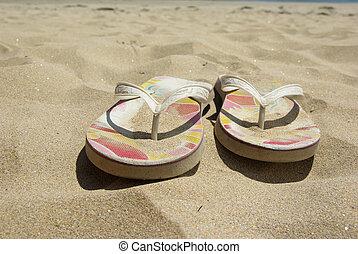 Flip-flop on beach