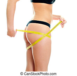 Slim female body with measure tape around hips Isolated on...