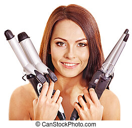 Woman holding iron curling hair. - Young woman holding iron...