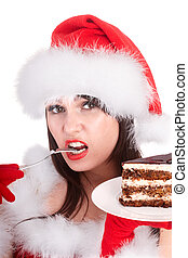 Christmas girl in santa hat and cake on plate - Christmas...
