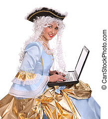 Woman in ancient dress with laptop. - Woman in ancient dress...