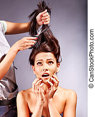 Woman at hairdresser. - Woman at hairdresser with iron hair...