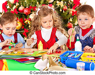 Kids making decoration for Christmas - Children boy and girl...