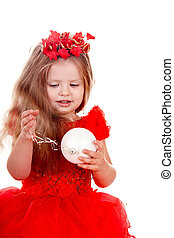 Girl child  in red dress with christmas ball.