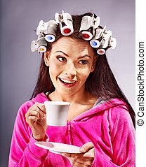 Woman wear hair curlers on head. - Woman wear hair curlers...