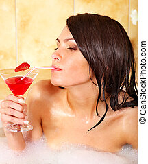 Woman relaxing in bath. - Woman washing in bubble bath.