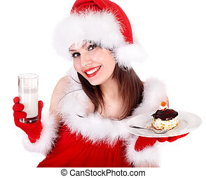 Girl in red Santa hat eating cake on plate - Christmas girl...
