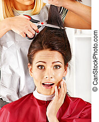 Woman at hairdresser - Woman at hairdresser with iron hair...
