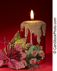 Christmas candle and poinsettia. - Christmas candle and...