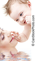 happy blue-eyed baby boy touching mama - picture of happy...
