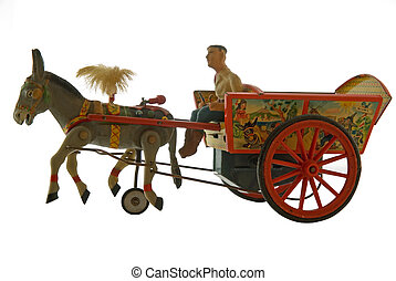 vintage tin toy - donkey with cart wind-up toy isolated