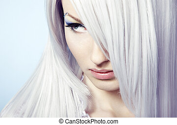 Fashion portrait of a young beautiful blonde woman