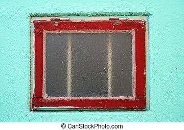 Small window - Red window against turquoise wall