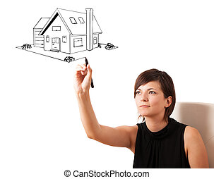 Young woman drawing a house on whiteboard