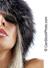 Fur passion - Portrait of a sexy beautiful blonde in fur