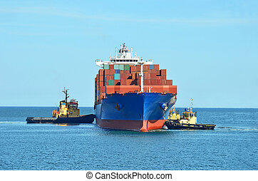 Tugboat assisting cargo ship - Tugboat assisting container...