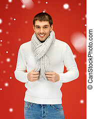 handsome man in warm sweater and scarf