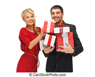 man and woman with gift boxes - picture of man and woman...