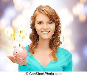 teenage girl with piggy bank - picture of teenage girl with...