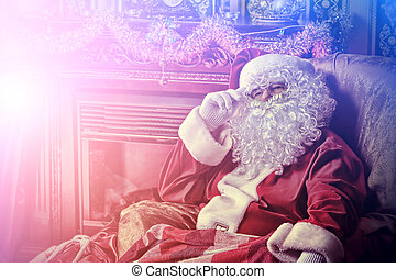 cool santa claus - Santa Claus having a rest in a...