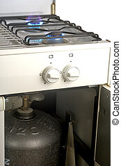 The gas butane or burning hot propane gas on a cooker