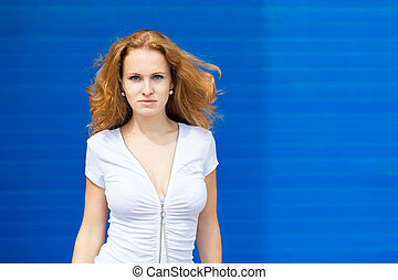 Young businesswoman posing over old factory