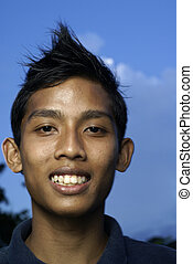 Malay teen smiling with blue sky