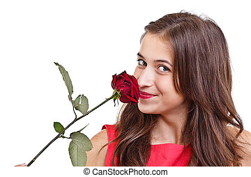 Woman smelling red rose - Portrait of happy woman smelling...