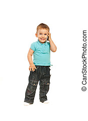 Happy toddler boy talking by phone