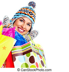 Beautiful shopping Christmas woman with bags. - Shopping...